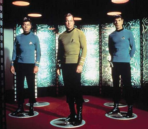 STAR TREK, DeForest Kelley, William Shatner, Leonard Nimoy standing on the transporter pad, 1966-1969. (www.britannica.com)